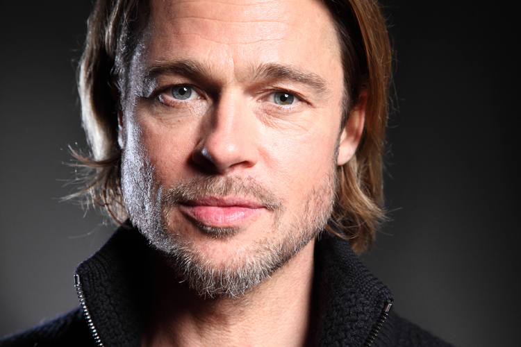 "In this Sept. 10, 2011 photo, actor Brad Pitt poses for a portrait to promote his film ""Moneyball"" during the 36th Toronto International Film Festival in Toronto, Canada. Pitt was obsessed with making a movie out of Michael Lewis' best-seller ""Moneyball: The Art of Winning an Unfair Game,"" which chronicles Oakland A's general manager Billy Beane's revolutionary experiment to build a winning team out of unlikely prospects and castoff players. (AP Photo/Carlo Allegri)"